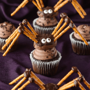 DIY Pretzel & Chocolate Spiders - using a Reese's Pumpkin as the body! These are great as a cake or cupcake topper...or all on their own!
