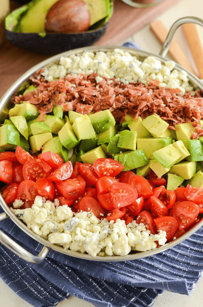 Copycat Maggiano's Chopped Salad Recipe! Crispy pancetta, avocado, tomatoes, blue cheese (or gorgonzola) and a delicious homemade dressing!