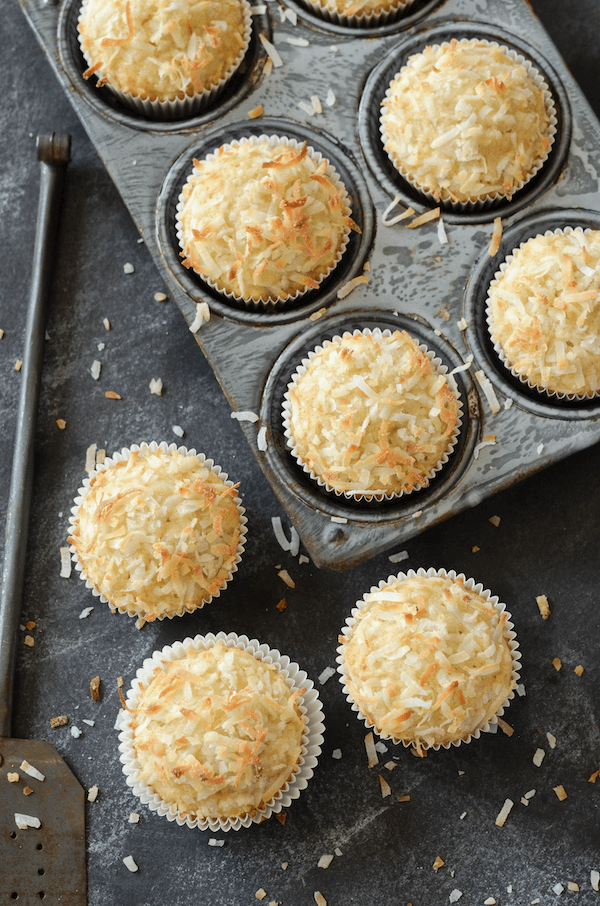 Coconut Banana Crunch Muffins -- a glorious crunchy sweetened toasted coconut top on top of a moist banana and coconut flavored muffin!