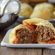 Meatball Bombs - garlic butter topped meatball & cheese stuffed bombs!