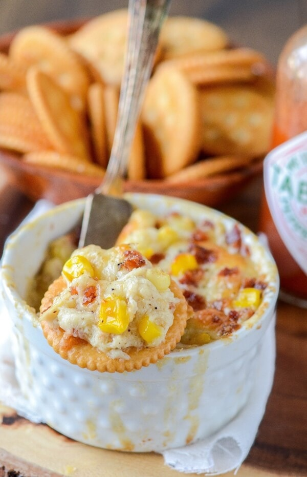 Hot Crab, Corn and Bacon Dip! Baked creamy crab dip filled with cheese, corn, bacon and jalapeños!