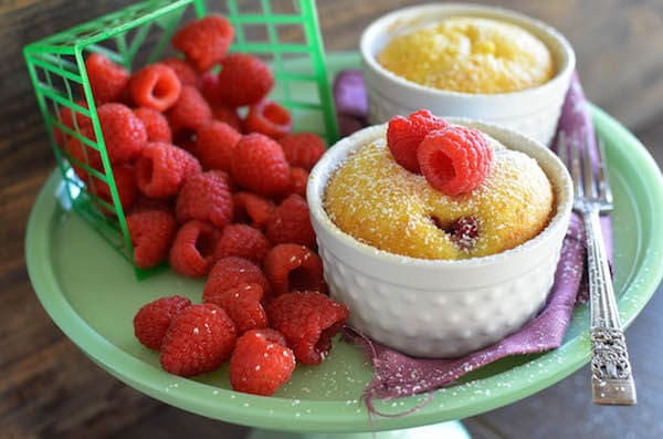 Warm Raspberry Pudding Cake with a vanilla butter sauce! It's a delicious easy way to impress your guests and no one would ever guess it started with a boxed cake mix!