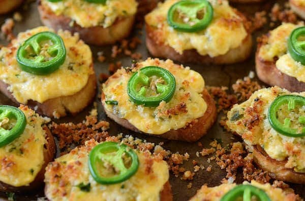 Jalapeño Popper Crostini! Buttery crostini toast topped with jalapeño popper dip and seasoned bread crumbs...then toasted till crispy perfection!