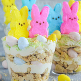 Oreo Easter Egg Cups - crushed vanilla oreos are layered with oreo cream filling buttercream and mini cadbury eggs!